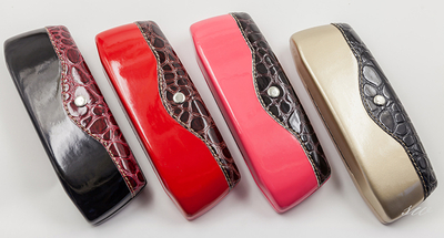 Four types of glasses cases printed with button patterns are novel in appearance