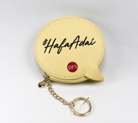 A Small Leather Bag in Drab Yellow, Round, And Printed with A LOGO in 2021. It Is Extremely Cute, Small, And Exquisite